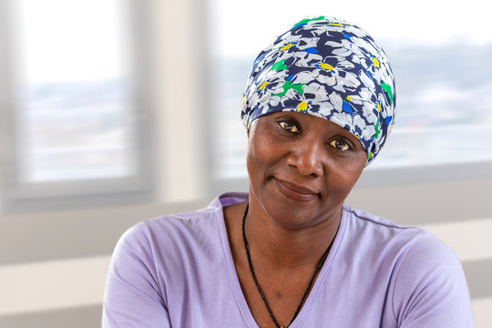 woman cancer patient wearing headscarf. Head, hope.African, American woman smiling