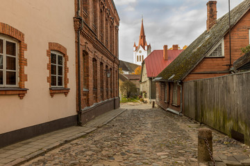 Wall Mural - Street with residential houses in the old town of Cesis