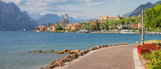 Malcesine - The promenade over the Lago di Garda lake with the town and castle in the background. Wall mural