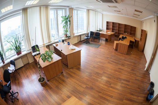 Vacant office space with leave furniture after leasholder moving, no people, wide angle view