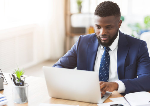 Young businessman working in modern high tech office