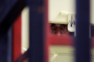 A gang member looks on from inside his cell during a media tour to the newly opened high security area of the Tamara prison, on the outskirts of Tegucigalpa