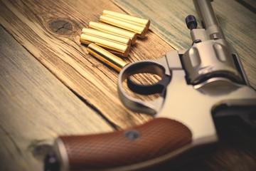 vintage revolver with cartridges