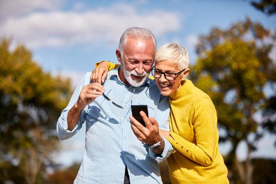 senior couple mobile phone happy cellphone