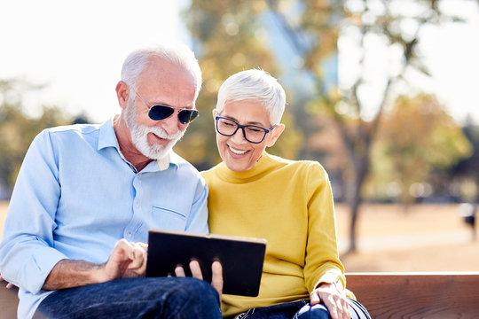 senior couple happy tablet computer internet smiling