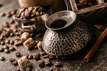 Fotobehang Koffiebonen Coffee cup and coffee beans on dark stone background.