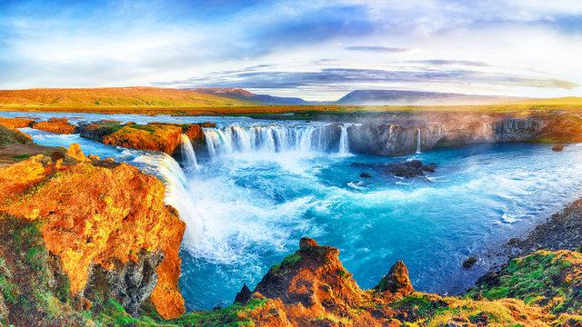 Fantastic sunrise scene of powerful Godafoss waterfall.