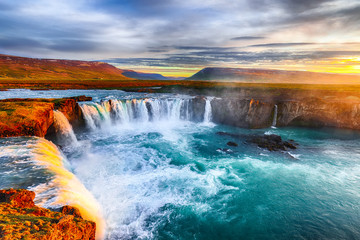 Fotobehang Watervallen Fantastic sunrise scene of powerful Godafoss waterfall.
