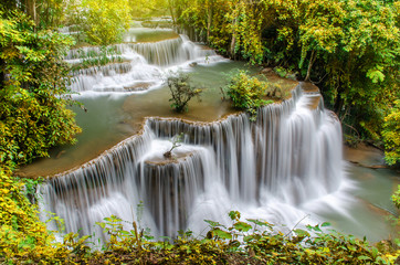 Tuinposter Bos rivier Travel to the beautiful waterfall in tropical rain forest, soft water of the stream in the Huai Mae Khamin Waterfall level 4, Khuean Srinagarindra National Park, Kanchanaburi, Thailand