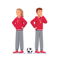 Pensive soccer coach standing next to soccer ball