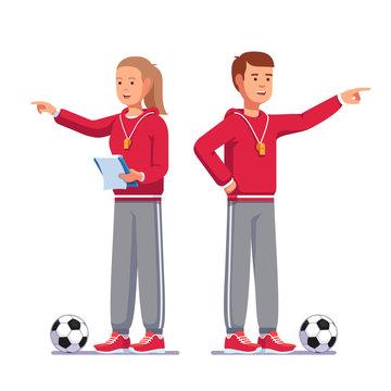 Soccer coach pointing finger talking football team
