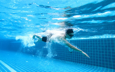 Underwater angle picture Men exercise Freestyle Swimming,