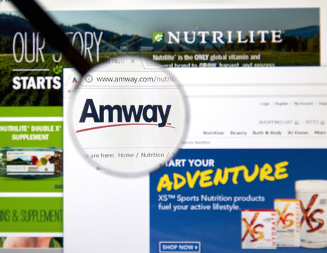 Amway web page under magnifying glass