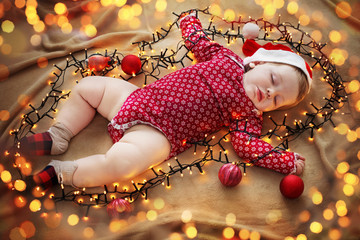 sleeping baby with Christmas decorations