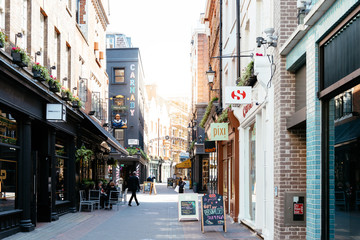 Shopping street with famous luxury clothing stores in Carnaby area in Soho in London