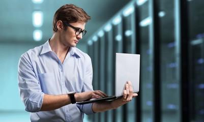 Man works in datacenter.