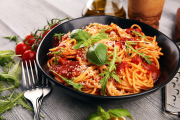 Plate of delicious spaghetti Bolognaise or Bolognese with savory minced beef and tomato sauce garnished with parmesan