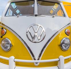 KIEL, GERMANY - JUNE 24, 2019: Front of a shiny classic yellow Volkswagen at the Kieler Woche festival