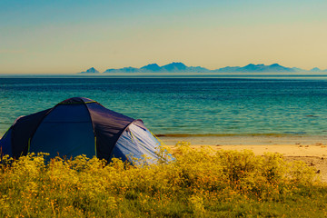 Seascape with tent on beach, Lofoten Norway