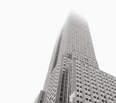 Empire State Building standing in fog