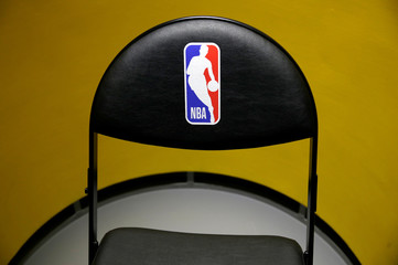 An NBA logo is seen on a chair at an NBA exhibition in Beijing