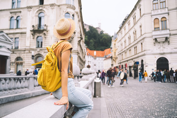 Young girl with backpack in  Ljubljana Old Town. Travel Slovenia