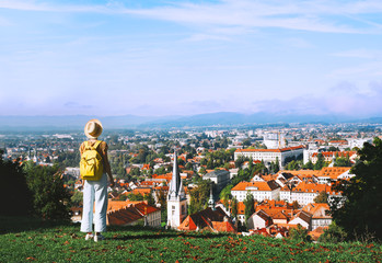 Young girl with backpack explores Ljubljana. Travel Slovenia