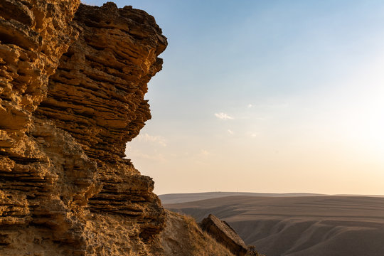 Cliff of sedimentary rocks against the blue sky