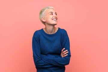 Teenager girl with white short hair over pink wall happy and smiling