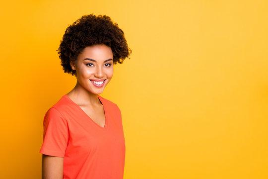 Close up photo of amazing dark skin lady with beaming smile wear orange v neck t-shirt isolated yellow color background