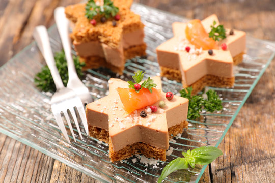 festive canape with foie gras and salmon