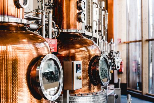 alembic still for making alcohol inside distillery