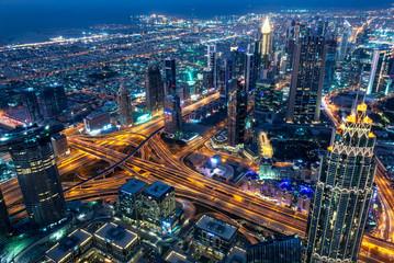 Wall Mural - Aerial view of Dubai at night seen from Burj Khalifa tower, United Arab Emirates