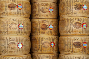 Wheels of Parmesan cheese on the market.
