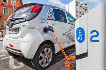 Electric car recharging at station.
