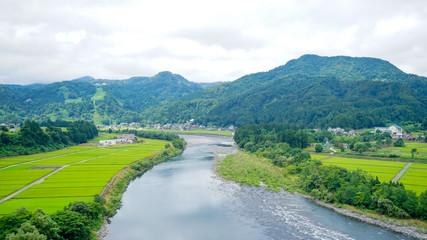 新潟県十日町の春の田んぼと川