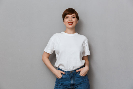 Image of pretty brunette woman wearing casual t-shirt smiling at camera