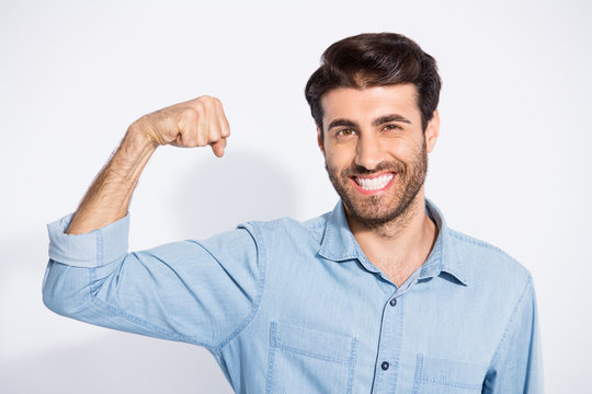 Now I'm stronger than yesterday. Photo of amazing handsome guy raising arm showing perfect biceps wear casual denim shirt isolated white color background