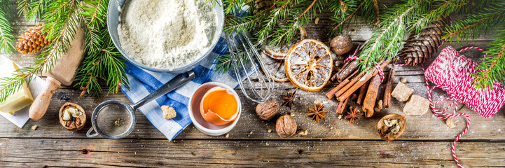 Christmas baking background with utensils and ingredients - flour, eggs, brown sugar and spices....