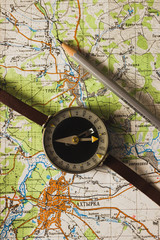 Trostyanets, Okhtyrka, Sumy oblast/ Ukraine. October, 8, 2019. Old compass and a pencil on the map background, concept of travel