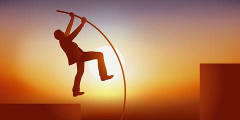 Concept de l'ambition et du leadership avec un homme qui utilise symboliquement une perche pour monter dans la hiérarchie et réussir sa carrière professionnelle