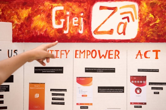 """""""GjejZa"""" app logo is pictured on a screen during a presentation in Tirana"""