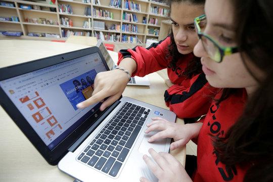 "Dea Rrozhani and Jonada Shukarasi creators of ""GjejZa"" app, work on laptop in Tirana"
