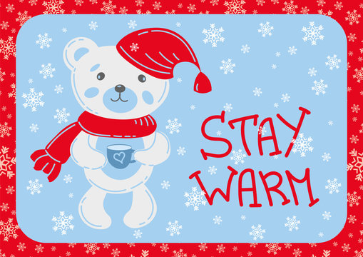 "Cute little Teddy bear with a cup, Lovely postcard with a little Teddy bear in a scarf and cap, with a cup. Hand-drawn lettering ""Stay Warm"" and snowflakes. Cozy winter illustration"