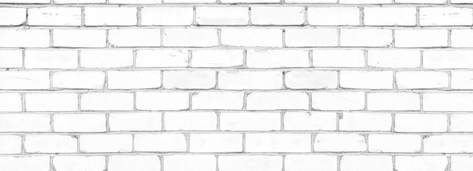 Old shabby white exterior brick wall texture. Cement block whitewashed widescreen background