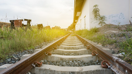 The low angle of the railroad with orange light.