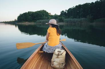 Shy canoe girl hiding her look back