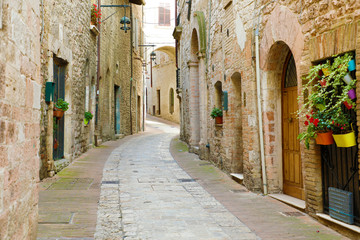 Beautiful Italian old city. Typical medieval architecture on cozy street in the heart of Italy.