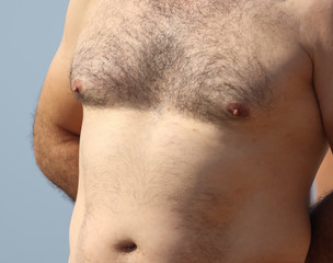 Hair on the chest and abdomen in a man