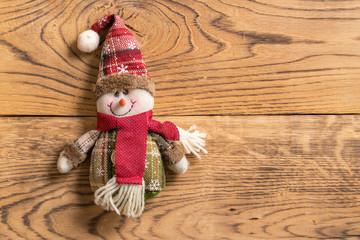 Snowman rag doll on wooden background